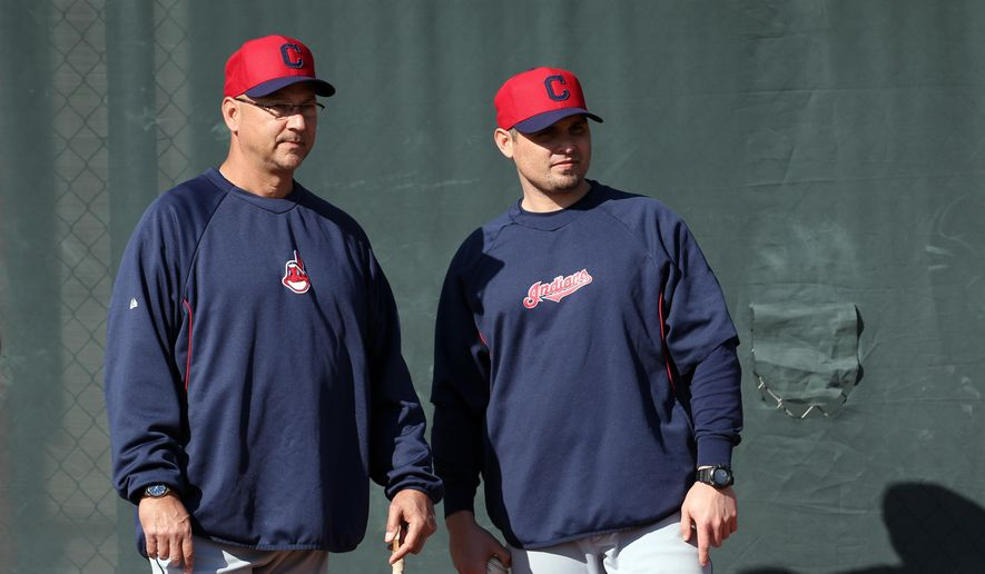 FILE - In this Feb. 12, 2013, file photo, Cleveland Indians manager Terry Francona, left, and bullpen coach Kevin Cash watch during spring training baseball in Goodyear, Ariz.  Cash was hired as the new manager of the Tampa Bay Rays on Friday, Dec. 5, 2014.  (AP Photo/Paul Sancya, File)