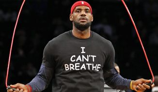 "LeBron James warms up before an NBA basketball game against the Brooklyn Nets at the Barclays Center, Monday, Dec. 8, 2014, in New York. Professional athletes have worn ""I Can't Breathe"" messages in protest of a grand jury ruling not to indict an officer in the death of a New York man. (AP Photo/Kathy Willens)  ** FILE **"