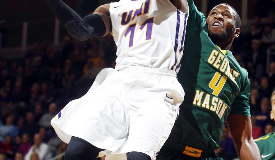 Northern Iowa's Wes Washpun, left, goes up for a shot as George Mason's Erik Copes draws the foul during the first half of an NCAA college basketball game Saturday, Dec. 6, 2014, in Cedar Falls, Iowa. (AP Photo/Waterloo Courier, Courtney Collins)