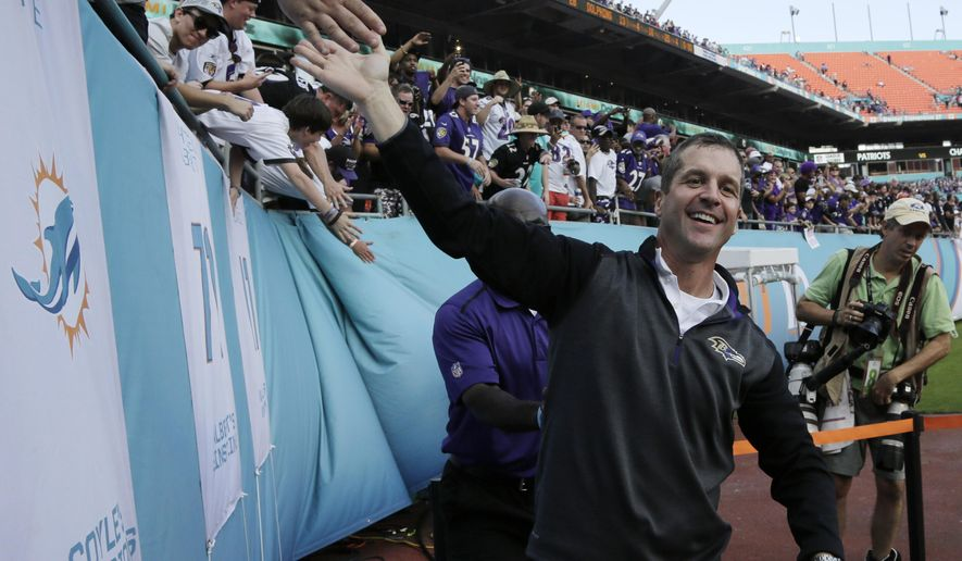 Baltimore Ravens head coach John Harbaugh greets fans after an NFL football game against the Miami Dolphins, Sunday, Dec. 7, 2014, in Miami Gardens, Fla.  The Ravens defeated the Dolphins 28-13. (AP Photo/Lynne Sladky)