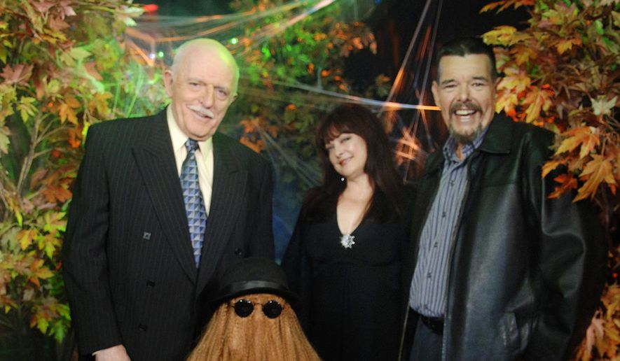 "This Oct. 31, 2006, photo provided by ABC, shows some of the original cast of the TV show, ""The Addams Family,"" from left, John Astin, (Gomez Addams), Felix Silla, (Cousin Itt), Lisa Loring, (Wednesday Addams) and Ken Weatherwax, (Pugsley Addams), reunited at a special Halloween edition of ABC's ""Good Morning America"" outside their Times Square studios in New York. (AP Photo/ ABC, Ida Mae Astute) ** FILE **"
