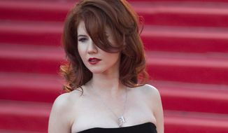 Russian Anna Chapman, who was deported from the U.S. in July 2010 on charges of espionage, poses on the red carpet at the opening ceremony of the 35th Moscow International Film Festival in Moscow on June 20, 2013. (AP Photo/Alexander Zemlianichenko Jr.) **FILE**