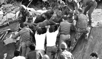 In this Oct. 23, 1983, file photo, British soldiers give a hand in rescue operations at the site of the bomb-wrecked U.S. Marine command center near the Beirut airport, Lebanon. A bomb-laden truck drove into the center collapsing the entire four story building. The blast _ the single deadliest attack on U.S. forces abroad since World War II _ claimed the lives of 241 American service members. (AP Photo/Bill Foley, File)