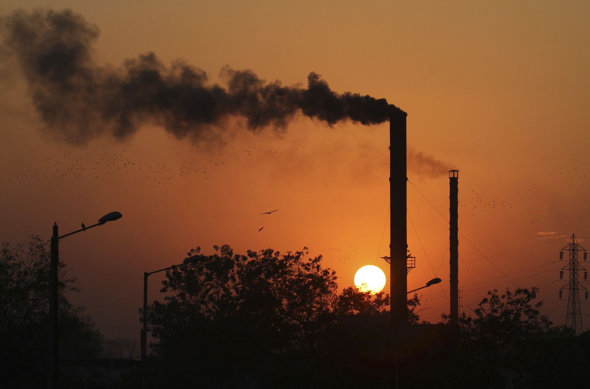 Third year of flat global carbon emissions fuels resistance to Paris climate accord