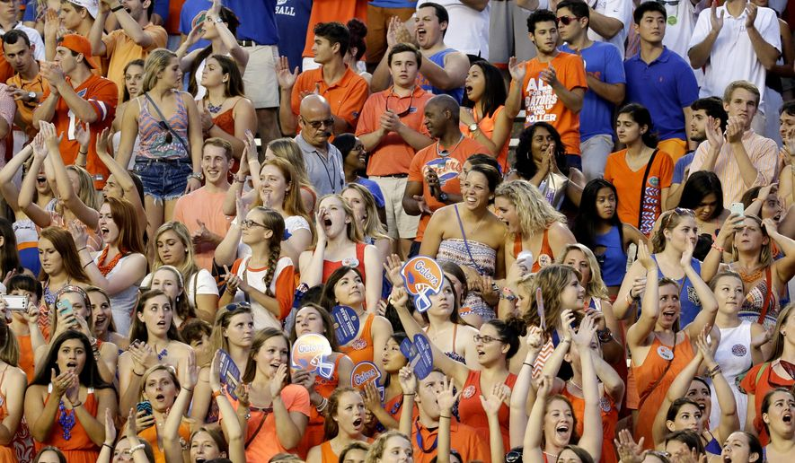 In this Saturday, Sept. 13, 2014, file photo, University of Florida fans in the student section cheer during the first half of an NCAA college football game between Florida and Kentucky in Gainesville, Fla. (AP Photo/John Raoux)