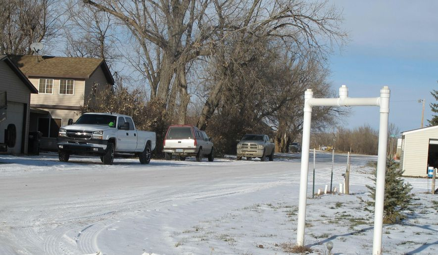 This Dec. 3, 2014 photo shows a street in the unincorporated village of Manning, the Dunn County, N.D., seat of government. Dunn County officials are exploring whether it's feasible to pave the gravel streets in Manning. (AP Photo/The Bismarck Tribune, Lauren Donovan)