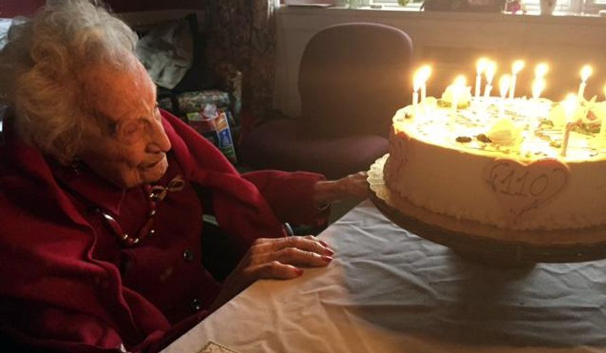 In this Dec. 6, 2014 photo provided by Mary-Kate Mele, Emily Tremonti sits in front of her cake on her 110th birthday in Fairfield, Conn. Tremonti grew up with four sisters in Mount Vernon, N.Y. One also lived to 100. (AP Photo/Mary-Kate Mele)