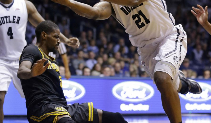 Butler forward Roosevelt Jones, right, shoots after being fouled by Kennesaw State forward Bernard Morena in the second half of an NCAA college basketball game in Indianapolis, Monday, Dec. 8, 2014. (AP Photo/Michael Conroy)