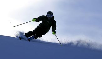 FILE - In this Nov. 23, 2013, file photo, a skier enjoys a run at Park City Mountain Resort, in Park City, Utah. Vail Resorts Inc. is announcing plans to build a high-speed gondola this summer that would connect its newly acquired Utah ski resort to another it owns to create what the company says will be the largest ski area in the United States. Vail announced the connecting lift plans Monday, Dec. 8, 2014, as part of $50 million in investments at Park City Mountain Resort and Canyons Resort. (AP Photo/Rick Bowmer, File)
