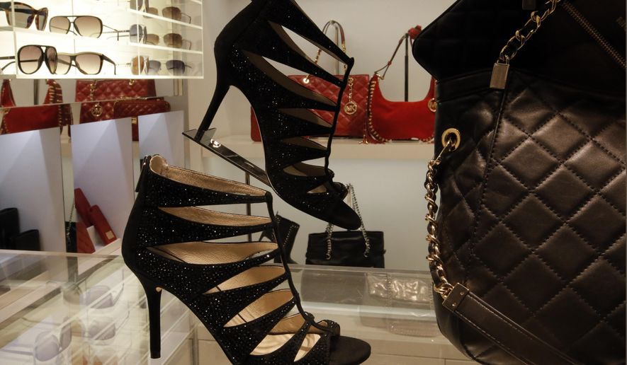 In this photo taken Sunday, Nov. 30, 2014 high heels are pictured in a shop of in Paris. Scientists from the Universite de Bretagne-Sud conducted experiments that showed that men behave very differently toward high-heeled women.  (AP Photo/Francois Mori)