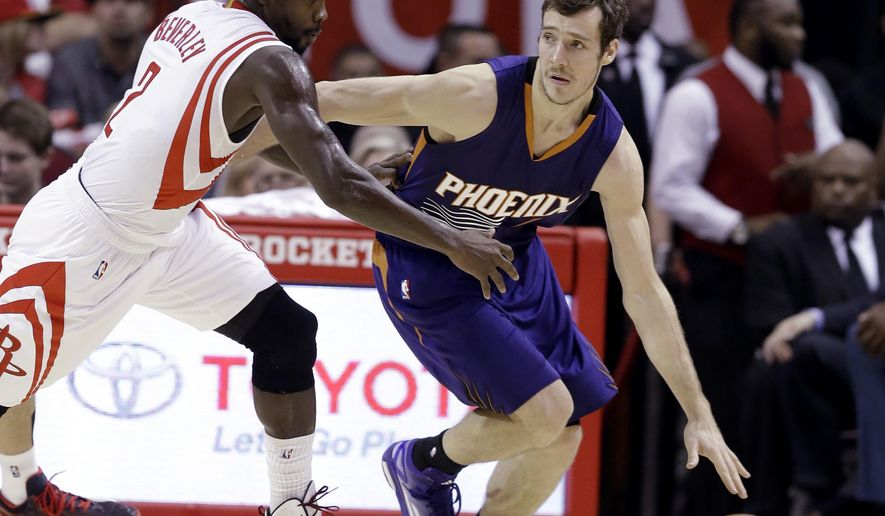 Phoenix Suns' Goran Dragic (1) is pressured by Houston Rockets' Patrick Beverley (2) in the second half of an NBA basketball game Saturday, Dec. 6, 2014, in Houston. The Rockets won 100-95. (AP Photo/Pat Sullivan)