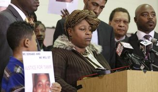 Samaria Rice, the mother of Tamir, a 12-year-old boy fatally shot by a Cleveland police officer, speaks during a news conference Monday, Dec. 8, 2014, in Cleveland. Surveillance video released by police shows Tamir Rice being shot within 2 seconds of a patrol car stopping within a few feet of him at a park on Nov. 22. (AP Photo/Tony Dejak)