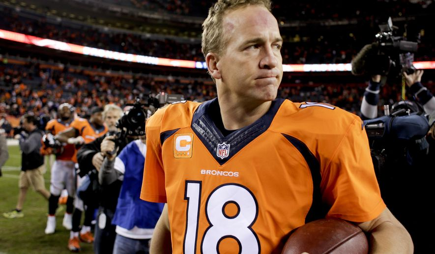 Denver Broncos quarterback Peyton Manning leaves to field after their 24-17 win against the Buffalo Bills in an NFL football game Sunday, Dec. 7, 2014, in Denver. (AP Photo/Joe Mahoney)