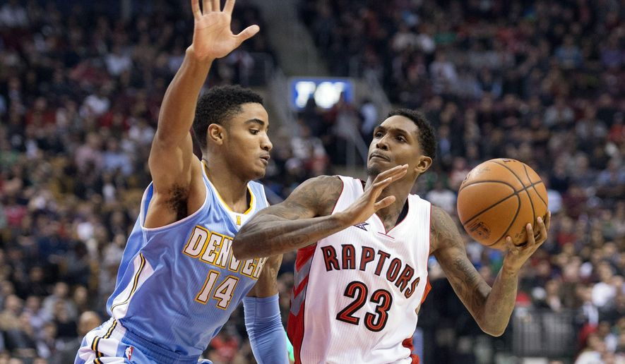 Toronto Raptors' Lou Williams, right, drives to the basket against Denver Nuggets' Gary Harris during the first half of an NBA basketball game in Toronto on Monday, Dec. 8, 2014. (AP Photo/The Canadian Press, Darren Calabrese)