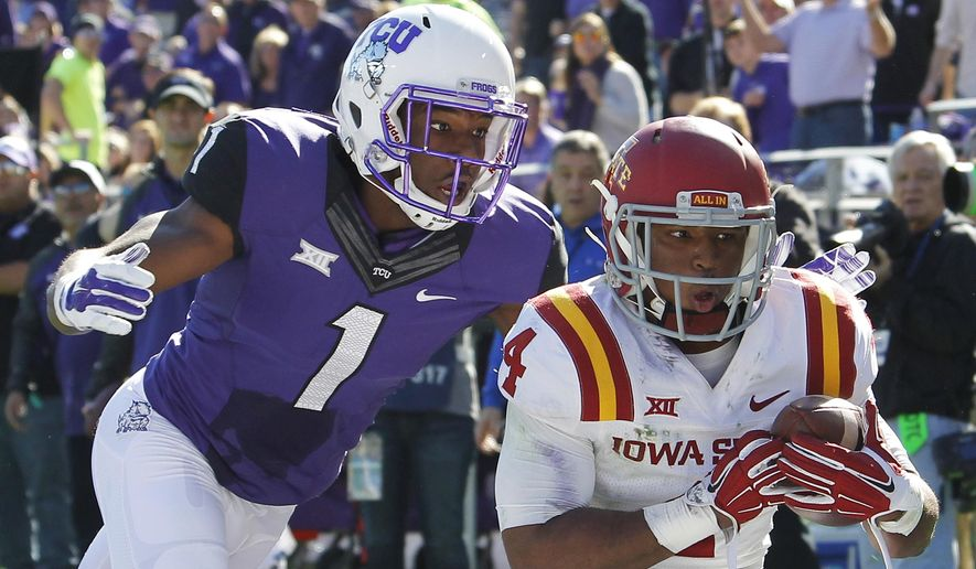 Iowa State wide receiver P.J. Harris (4) beats TCU wide receiver Emanuel Porter (1) for a second quarter interception in the end zone as TCU beats Iowa State 55-3 in an NCAA college football game in Fort Worth, Texas, Saturday, Dec. 6, 2014. (AP Photo/The Fort Worth Star-Telegram, Paul Moseley)