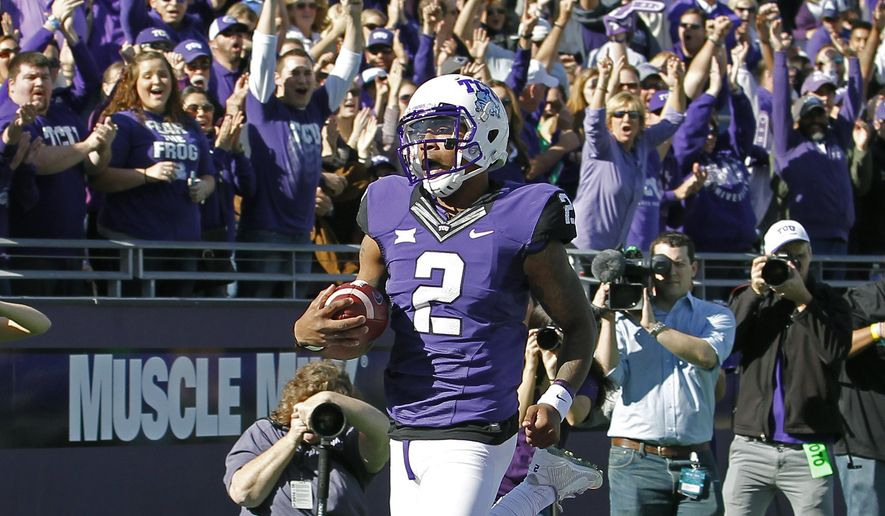 TCU quarterback Trevone Boykin (2) scores a touchdown during the first half of an NCAA college football game against Iowa State at Amon G. Carter Stadium, Saturday, Dec. 6, 2014, in Fort Worth, Texas. \(AP Photo/The Fort Worth Star-Telegram, Paul Moseley)  MAGS OUT; (FORT WORTH WEEKLY, 360 WEST); INTERNET OUT
