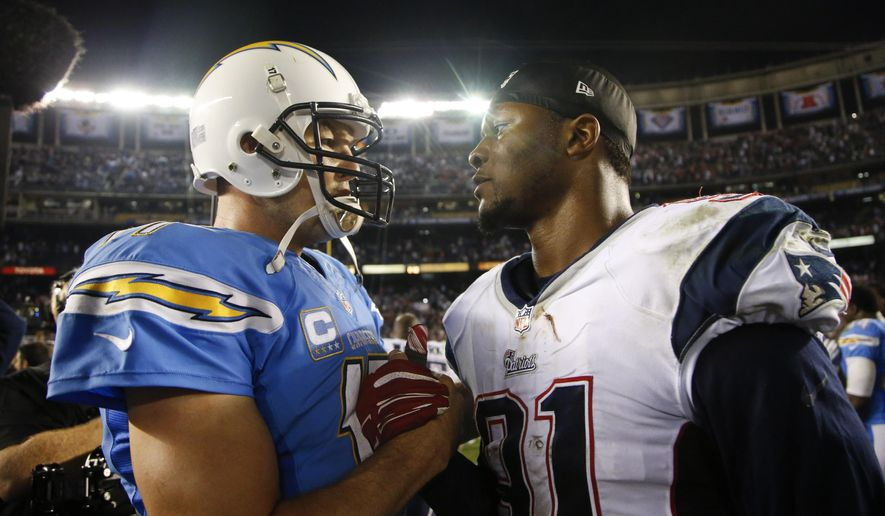 San Diego Chargers quarterback Philip Rivers talks with New England Patriots outside linebacker Jamie Collins after the Patriots defeated the Chargers in an NFL football game Sunday, Dec. 7, 2014, in San Diego. (AP Photo/Lenny Ignelzi)