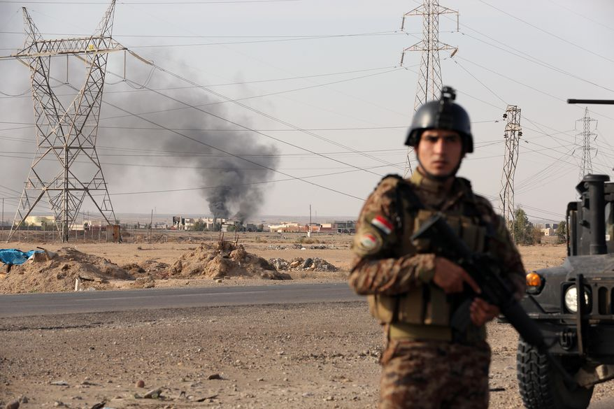 An Iraqi soldier stand guard after a military operation to regain control of villages around the town of Beiji, some 250 kilometers  (155 miles) north of Baghdad, Iraq, Monday, Dec. 8, 2014.  The commander of U.S. forces fighting the Islamic State in Iraq and Syria, Army Lt. Gen. James Terry says the extremist group has been thrown on the defensive, because coalition airstrikes and other measures are taking a toll on IS ability to communicate. (AP Photo/Hadi Mizban)