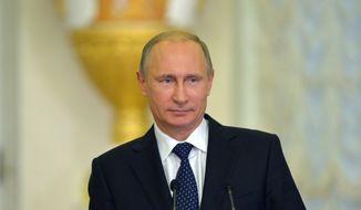 (AP Photo/RIA-Novosti, Alexei Druzhinin, Presidential Press Service)