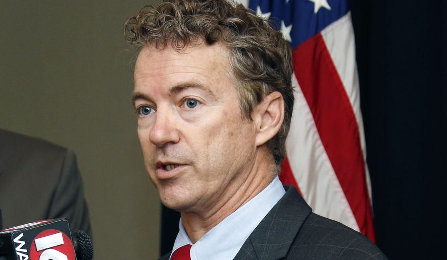 U.S. Sen. Rand Paul, R-Ky., speaks with reporters Monday, Dec. 8, 2014 in Jackson, Miss. Paul was in the state to headline a fundraiser for the Mississippi Republican Party. (AP Photo/Rogelio V. Solis)