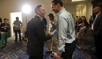 Oakland Athletics manager Bob Melvin, right, greets Minnesota Twins manager Paul Molitor during Major League Baseball's winter meetings Monday, Dec. 8, 2014, in San Diego. Baseball's winter meetings opened Monday with Oakland jettisoning yet another All-Star, Brandon Moss. (AP Photo/Gregory Bull)