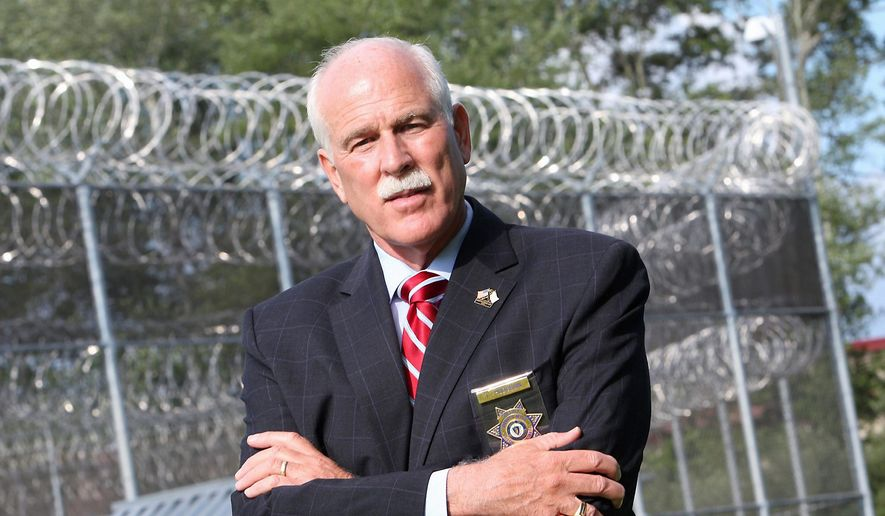 Bristol County Sheriff Thomas M. Hodgson emphasized the symbolism of using inmates to help build the border wall. (Associated Press)
