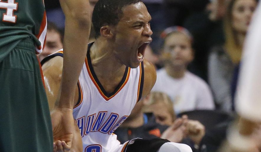 Oklahoma City Thunder guard Russell Westbrook (0) shouts after a dunk against the Milwaukee Bucks in the second quarter of an NBA basketball game in Oklahoma City, Tuesday, Dec. 9, 2014. (AP Photo/Sue Ogrocki)