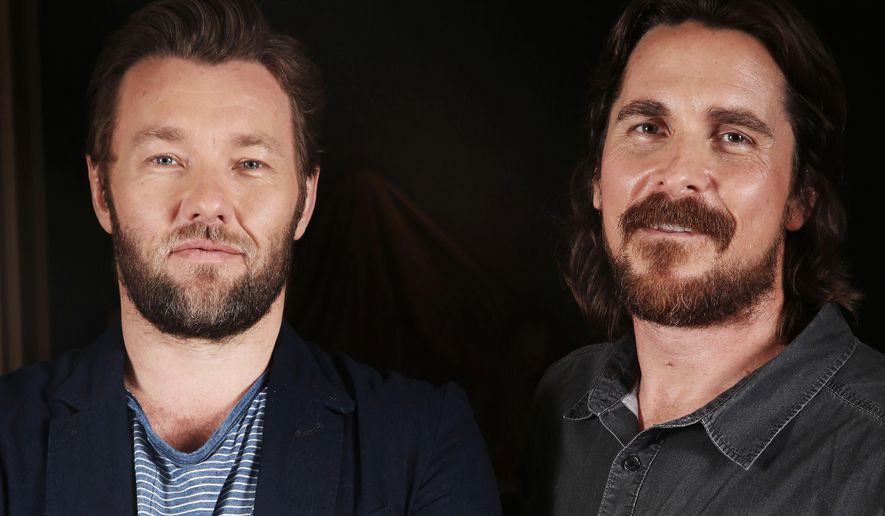 """In this Thurs., Sept. 11, 2014 photo, Joel Edgerton, left, and Christian Bale pose for a portrait while promoting """"Exodus: Gods and Kings"""" in Los Angeles. Bale stars opposite Edgerton in the Ridley Scott epic opening Friday, Dec. 12, 2014. Other stars include Sigourney Weaver and John Turturro.  (Photo by Matt Sayles/Invision/AP)"""