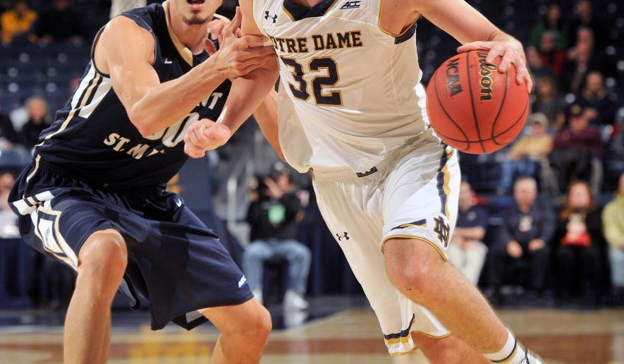 Notre Dame guard Steve Vasturia, right, drives the lane while Mount Saint Mary's forward Taylor Danaher defends in the first half of an NCAA college basketball game, Tuesday Dec. 9, 2014, in South Bend, Ind. (AP Photo/Joe Raymond)