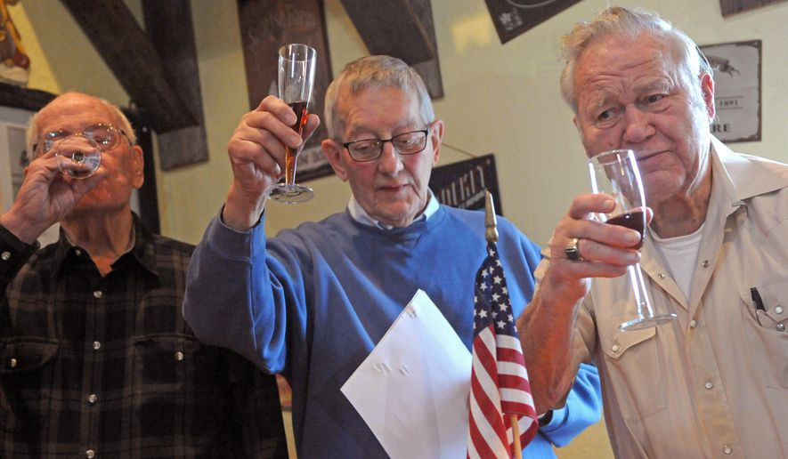 In this photo taken on Monday, Dec. 8, 2014, from left, Bob Mordick, 89, Kelly Brookman, 87 and Gene Peltier, 88, make a toast at the final meeting of the Kilroy Last Man Standing Club, a World War II veterans' club, in Lake Elmo, Minn.  The 53 World War II veterans who formed the club are mostly gone, and five of the remaining seven members voted on Monday to end the club. Group members said their final toasts after opening the ceremonial bottle of wine they bought in 1954.  (AP Photo/The St. Paul Pioneer Press, Scott Takushi)  MINNEAPOLIS STAR TRIBUNE OUT