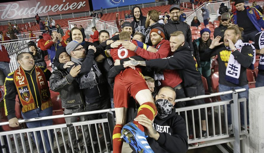 FILE - In this Oct. 22, 2014, file photo Real Salt Lake defender Nat Borchers (6) celebrates with fans following the team's 2-0 victory over Chivas USA in an MLS soccer game, in Sandy, Utah. The Timbers have acquired veteran defender Nat Borchers from Real Salt Lake, one of a flurry of moves Monday for Portland's Major League Soccer team. (AP Photo/Rick Bowmer, File)