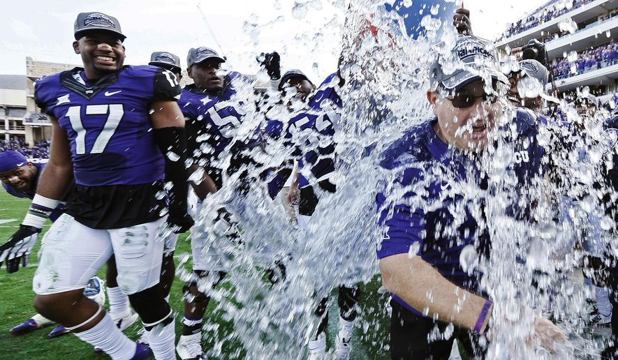 TCU head coach Gary Patterson is doused by his players after their 55-3 win over Iowa State in an NCAA college football game at Amon G. Carter Stadium, Saturday, Dec. 6, 2014, in Fort Worth, Texas. (AP Photo/Brandon Wade)