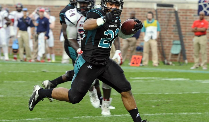 Coastal Carolina running back, Andre Johnson out races the Richmond defense for a touch down during their second round Football Championship Subdivision playoff game at Brooks Stadium in Conway. (AP Photo/The Sun News, Charles Slate)