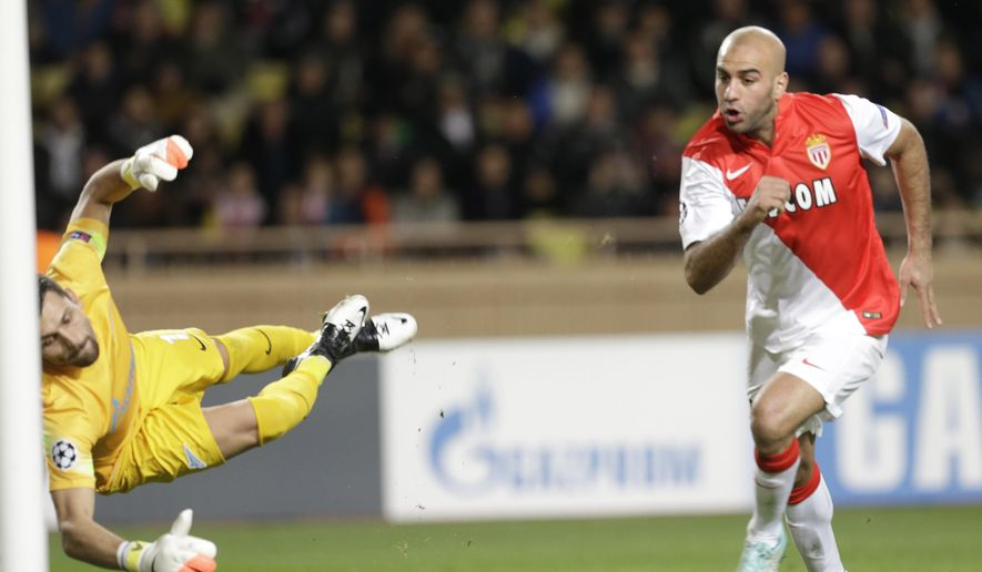 Monaco's Aymen Abdennour, right, scores the opening goal past Zenit's goalkeeper Yuri Lodygin during the Champions League Group C soccer match between Monaco and Zenit St. Petersburg at Louis II stadium in Monaco, Tuesday, Dec. 9, 2014. (AP Photo/Lionel Cironneau)