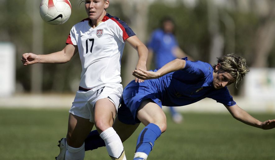 """FILE - In this March 7, 2008, file photo, Lori Chalupny, left, of the U.S., vies for the ball with Italy's Melania Gabbiadini, right, during their Algarve Cup women's soccer match in Alvor, Portugal. Chalupny was called one of the """"top five players in the world"""" a few years ago by a former coach. Despite this, she hasn't played for the United States national team in five years, sidelined by a history of concussions. That could change in Brazil, where Chalupny has returned to the U.S. team for a four-team tournament starting Wednesday Dec. 10, 2014, in the capital Brasilia against Brazil, China and Argentina. She's hoping to make the final American team for next year's World Cup in Canada. (AP Photo/Armando Franca, File)"""