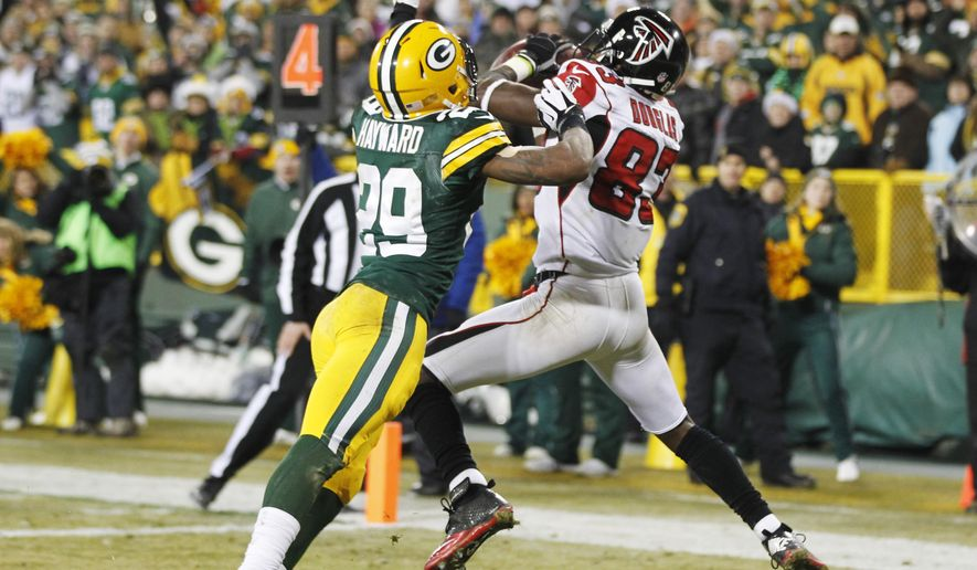 Atlanta Falcons' Harry Douglas catches a two-yard touchdown pass in front of Green Bay Packers' Demetri Goodson (39) during the second half of an NFL football game Monday, Dec. 8, 2014, in Green Bay, Wis. The Packers won 43-37. (AP Photo/Mike Roemer)