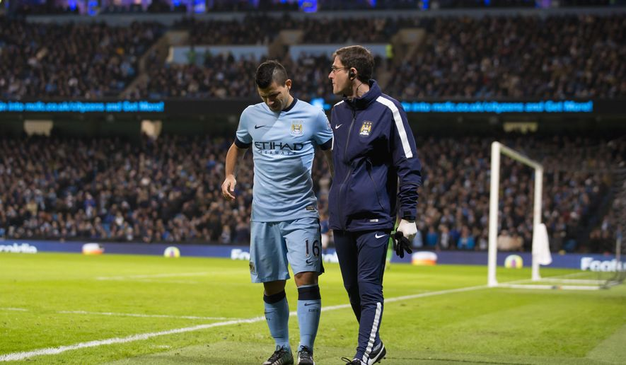Manchester City's Sergio Aguero, left, walks off injured during the English Premier League soccer match between Manchester City and Everton at the Etihad Stadium, Manchester, England, Saturday Dec. 6, 2014. (AP Photo/Jon Super)