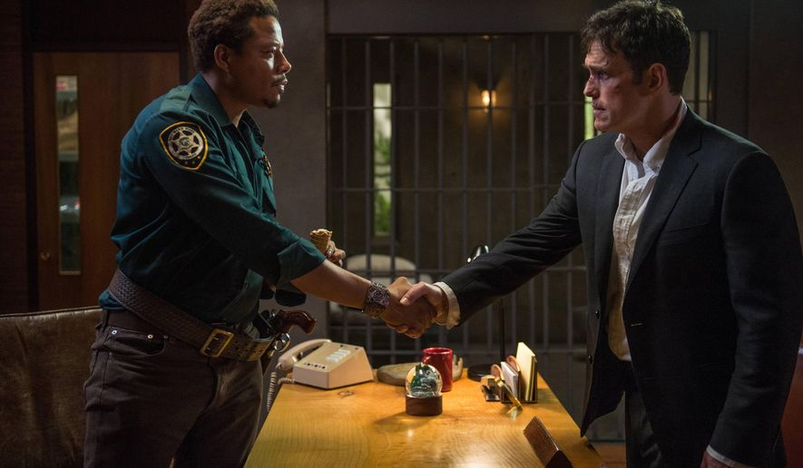 "In this image released by Fox,  Matt Dillon, portraying Ethan Burke, right, appears with Terrence Howard, portraying Sheriff Arnold Pope in a scene from the series ""Wayward Pines,"" premiering May 14. (AP Photo/Fox, Ed Araquel)"