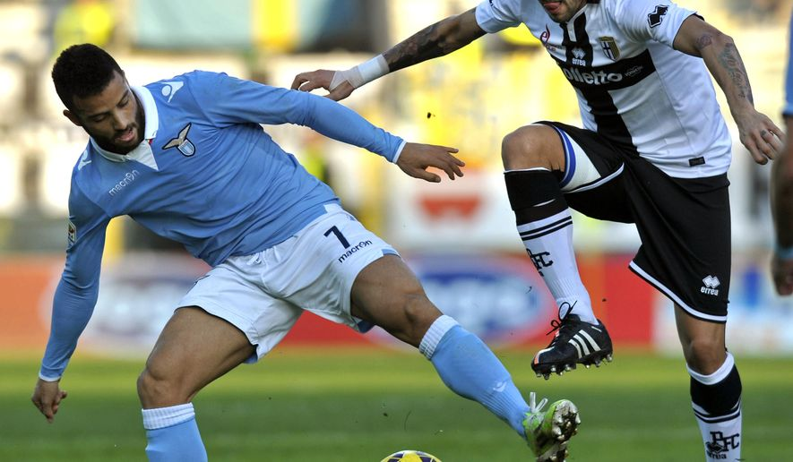 Parma's Francesco Lodi, right, vies for the ball with Lazio's Felipe Anderson, during their Serie A soccer match at Parma's Tardini stadium, Italy, Sunday, Dec. 7, 2014. (AP Photo/Marco Vasini)