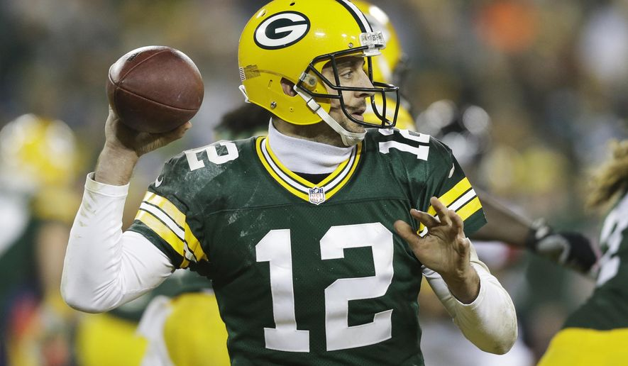 Green Bay Packers' Aaron Rodgers drops back to pass during the second half of an NFL football game against the Atlanta Falcons Monday, Dec. 8, 2014, in Green Bay, Wis. (AP Photo/Tom Lynn)