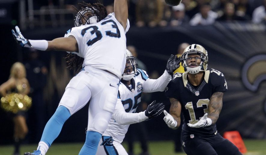 Carolina Panthers free safety Tre Boston (33) leaps as cornerback Bene' Benwikere (25) intercepts a pass intended for New Orleans Saints wide receiver Joseph Morgan (13) in the first half of an NFL football game in New Orleans, Sunday, Dec. 7, 2014. (AP Photo/Bill Feig)