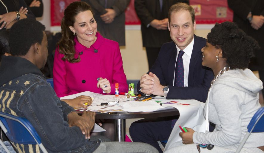 Britain's Prince William, Duke of Cambridge, right, and his wife Kate, Duchess of Cambridge, talk with students Nya Hayer, right, and Steffon Bell as they visit The Door Tuesday, Dec. 9, 2014. The Door provides services to disadvantaged young people. William and Kate are on the last of their 3-day tour of New York City, their first visit to the United States since a trip to California in 2011. (AP Photo/Chad Rachman, New York Post, Pool)
