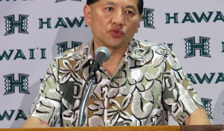 Hawaii Athletic Director Ben Jay announces his resignation at a news conference in Honolulu on Tuesday, Dec. 9, 2014. Jay cited family reasons for his resignation after two years at the university. (AP Photo/Audrey McAvoy)