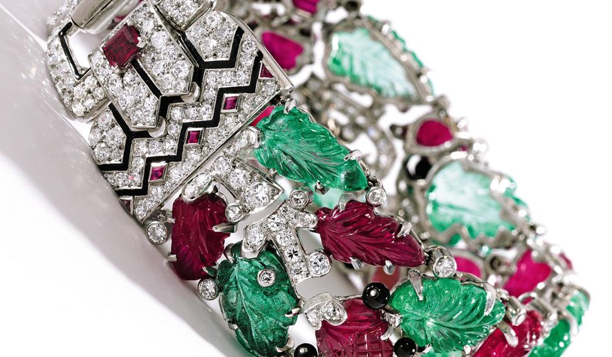 FILE - This file photo provided by Sotheby's, Monday, Oct. 27, 2014, shows a ruby, emerald and diamond Cartier Tutti Frutti bracelet. The jewelry is part of the collections of Estee Lauder and Evelyn Lauder that will be auctioned at Sotheby's, Tuesday, Dec. 9, 2014 in New York. (AP Photo/Sotheby's, File)