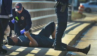 A Charlotte firefighter tends to Carolina Panthers NFL football quarterback Cam Newton following a two-vehicle crash not far from the team's stadium in Charlotte, N.C., Tuesday, Dec. 9, 2014. (AP Photo/The Charlotte Observer, Todd Sumlin) MAGS OUT; TV OUT; NEWSPAPER INTERNET ONLY
