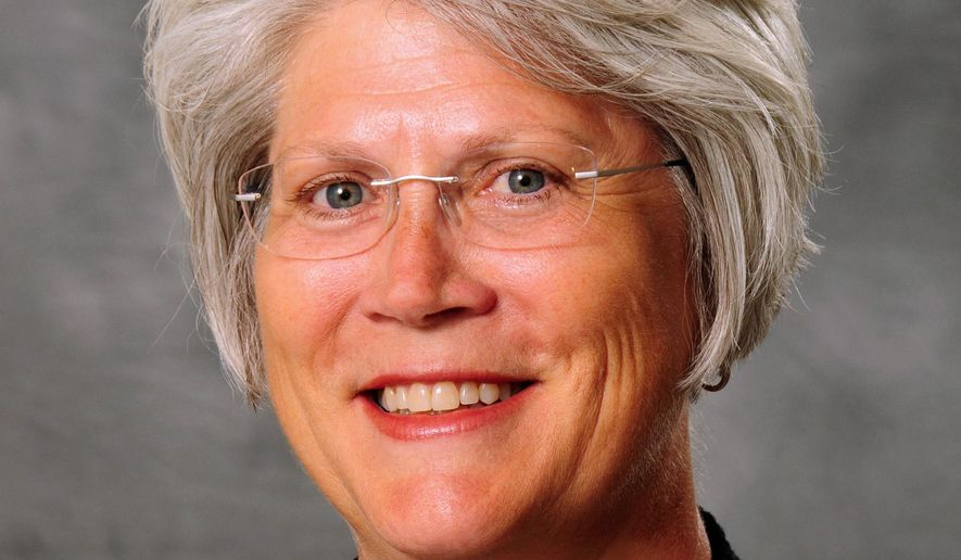 FILE - In this file photo provided by the University of Iowa athletics department is senior associate athletic director Jane Meyer. The University of Iowa is reassigning Meyer saying she cannot remain in the department while her fired partner prepares to sue for gender bias. (AP Photo/University of Iowa, File)