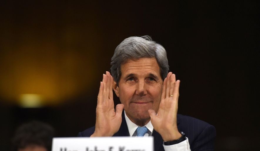 """Secretary of State John Kerry greets committee members as he arrives on Capitol Hill in Washington, Tuesday, Dec. 9, 2014, to testify before the Senate Foreign Relations hearing on """"Authorization for the Use of Military Force Against IS.""""  (AP Photo/Molly Riley)"""