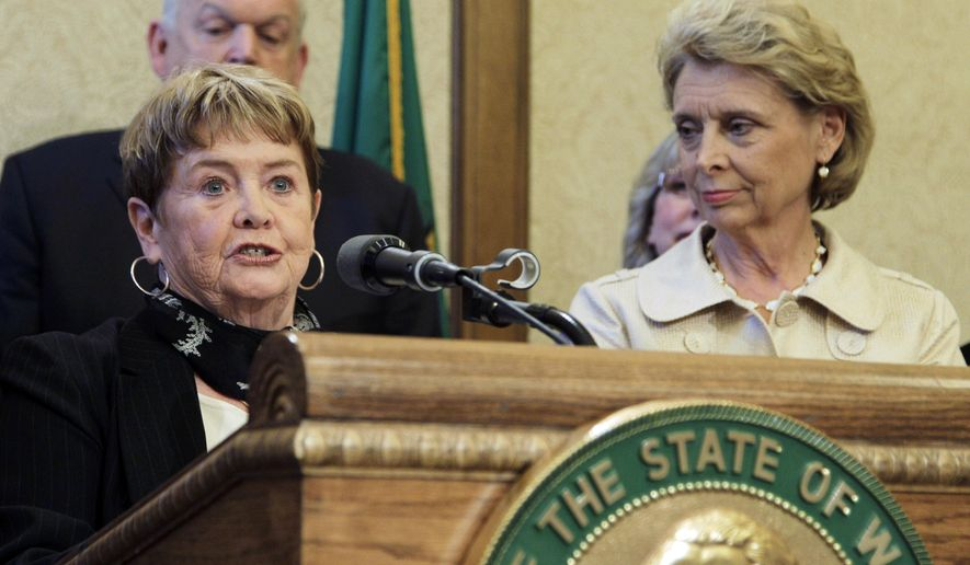 """FILE -- In this Nov. 10, 2010, file photo, Washington Gov. Chris Gregoire, right, looks on as Washington State Liquor Control Board chairwoman Sharon Foster talks to reporters at the Capitol in Olympia, Wash. Foster is retiring as head of the board and is now speaking freely. She said that privatizing liquor sales was """"the dumbest thing we ever did in our state."""" (AP Photo/Ted S. Warren, File)"""
