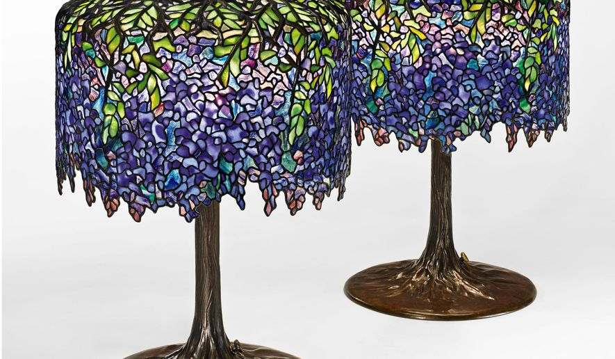 This undated photo provided by Sotheby's shows two nearly identical Tiffany wisteria lamps designed in 1901 that will be sold by Sotheby's on Dec. 17.  The lamps, which are among more than 30 other Tiffany lots in the auction, could sell for up to $1 million each at auction. (AP Photo/Sotheby's)
