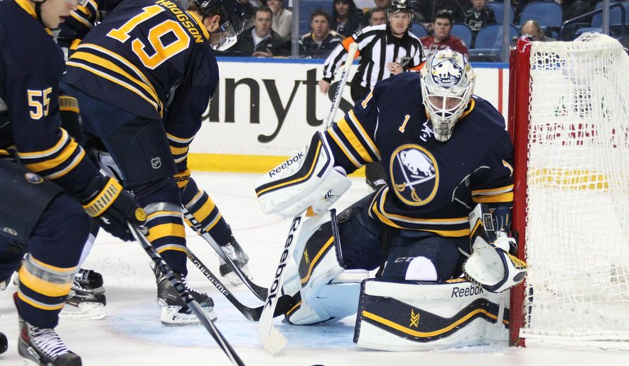 Buffalo Sabres' Jhonas Enroth (1), of Sweden, Rasmus Ristolainen (55), of Finland, and Cody Hodgson (19) defend the net against the Los Angeles Kings during the first period of an NHL hockey game Tuesday, Dec. 9, 2014, in Buffalo, N.Y. (AP Photo/Jen Fuller)
